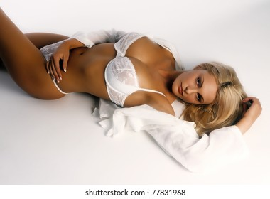 Beautiful sexy woman laying on her back wearing her lingeri