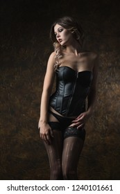 Beautiful sexy woman in leather corset