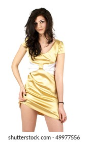 Beautiful sexy woman in little yellow silk dress isolated over white background