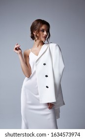 Beautiful sexy woman makeup wear fashion summer collection clothes style party office dress code wedding jacket slim body pretty face model accessory jewelry brunette hair jewelry white bride.