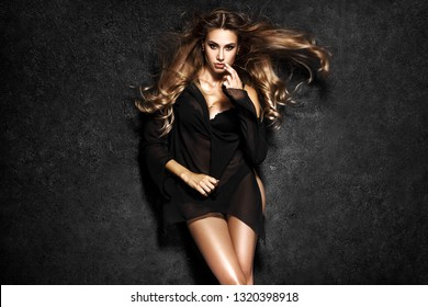 Beautiful sexy woman on black background