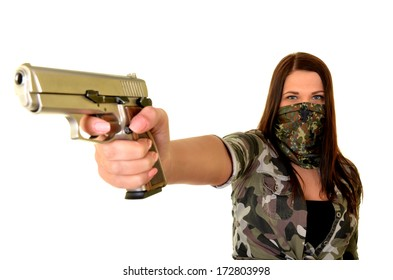 Beautiful sexy woman posing with a gun over white background.
