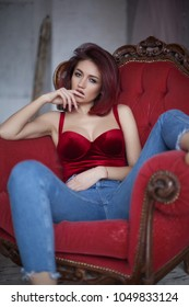 beautiful sexy woman in red bodysuit and jeans