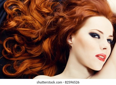 Beautiful sexy woman with red hair