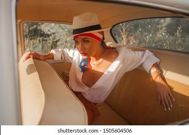 beautiful sexy woman in retro car