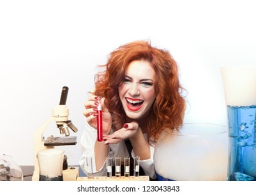 Beautiful Sexy woman Scientist with a test beaker of Love Potion fresh for Valentine's Day