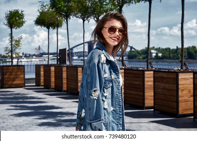 Beautiful sexy woman  skin is shod in high-heeled shoes depilation body care catologue stylish fashion collection walks on the street health body care cream white dress denim jacket.