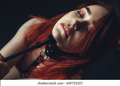 Beautiful sexy woman slave in a collar. Bdsm