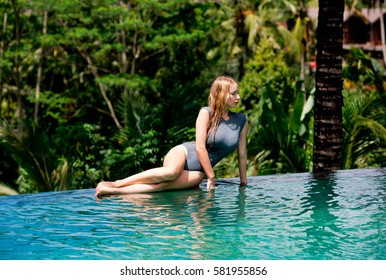 Beautiful sexy Woman Swimming Pool. Tropical Vacation.