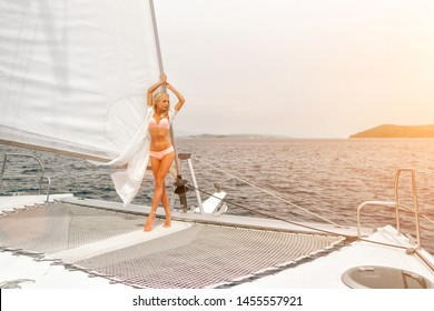beautiful sexy woman in swimwear relaxing on a yacht front