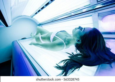Beautiful sexy woman tanning in solarium