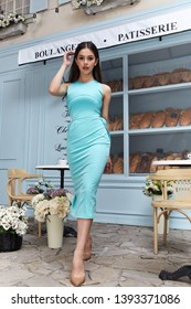 Beautiful sexy woman wear fashion summer collection clothes casual style blue cotton dress slim body pretty face model pose accessory jewelry brunette hair bread shop cafe breakfast morning coffee.