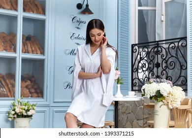 Beautiful sexy woman wear fashion summer collection clothes casual style white dress slim body pretty face model pose accessory jewelry brunette hair bread shop cafe breakfast morning coffee.