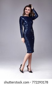 Beautiful sexy woman wear lux skinny blue dress shiny sequins style for party celebrate New Year Christmas beauty salon hair style makeup perfect body shape jewelry model pose fashion clothes glamour.