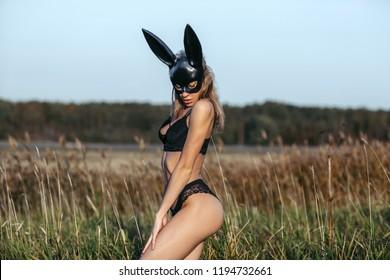 Beautiful sexy woman wearing black fashion bunny mask