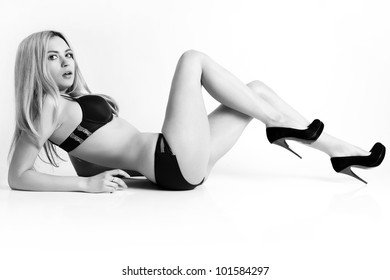 Beautiful and sexy woman wearing lingerie.  Black and white photo.