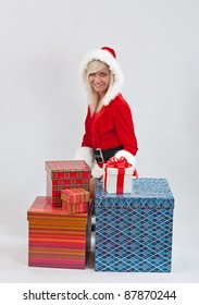 Beautiful and sexy woman wearing santa clause costume with gift