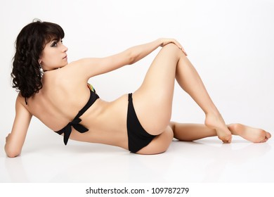 Beautiful and sexy woman wearing swimsuit. Women posing in the studio on white background.