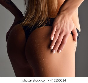 Beautiful sexy woman wet ass butts with water drops isolated on a white background