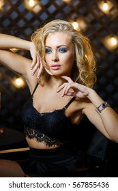 Beautiful sexy young blonde girl model with makeup and perfect body