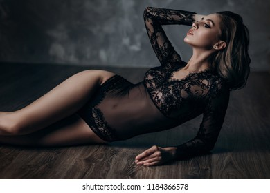 beautiful sexy young blonde woman posing in black lace lingerie