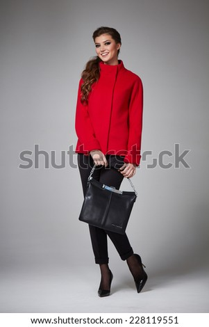 26b8f48d5655 Beautiful sexy young business woman with evening make-up wearing a dark  skirt to the knee wool red coat jacket high boots high heels