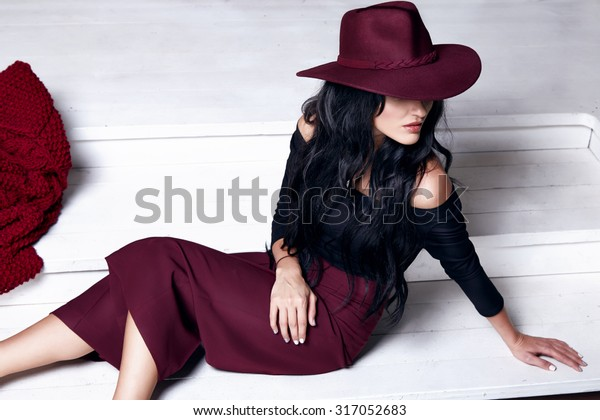 Beautiful sexy young business woman blond hair evening makeup wearing dress suit top skirt high heels shoes business clothes for meetings walks autumn fall collection perfect body shape make-up cap