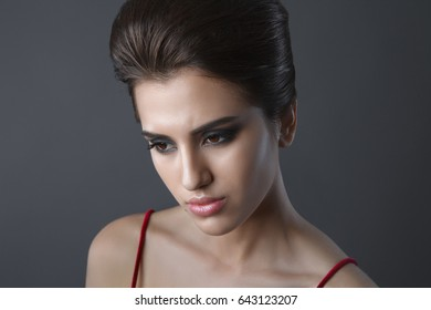 Beautiful sexy young girl is sad and upset.