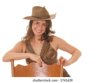 Beautiful and sexy young girl wearing cowboy hat
