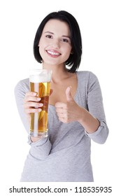 Beautiful and sexy young woman with glass of beer gesturing thumbs up, isolated on white