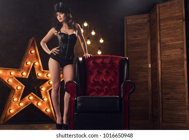 beautiful sexy young woman in lingerie on the background of a star with lamps