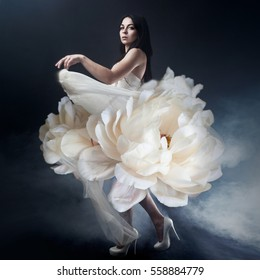 Beautiful sexy young woman. Portrait of girl in long white dress like a flower, photos art