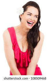 A beautiful sexy young woman in a red dress laughing