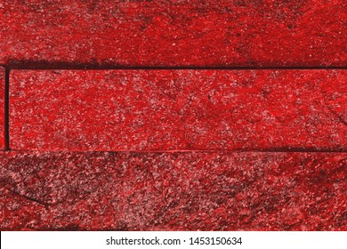 beautiful shabby red natural quartzite stone bricks texture for use as background.