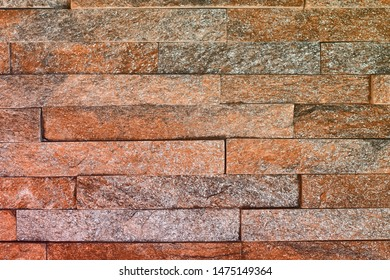 beautiful shabby red natural quartzite stone bricks texture for background use.