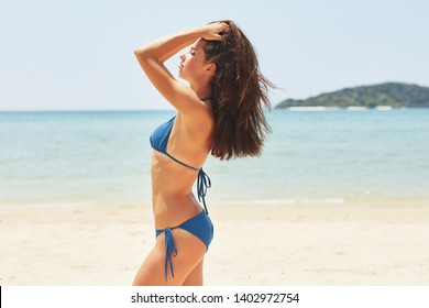 beautiful shapely woman on the beach. Holiday time