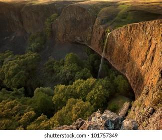 Beautiful sheer waterfall (Phantom Falls) off cliff on Table Mountain of California