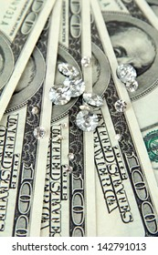 Beautiful shining crystals (diamonds) on money background
