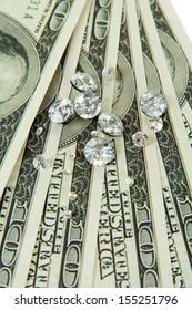 Beautiful shining crystals (diamonds) on money background