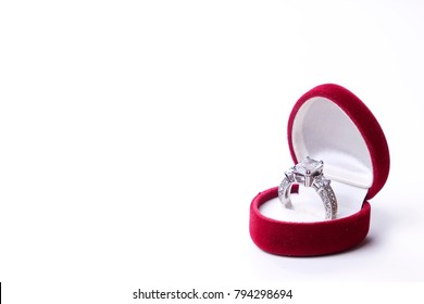 931c18032 Beautiful shiny platinum engagement ring with big gem diamond in rich red  velvet box isolated on