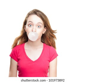Beautiful and shocked or surprised young student girl blowing bubble from chewing gum. Looking into the camera. Isolated on white background.