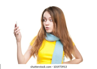Beautiful and shocked or surprised young student girl holding cell phone in her hand. Looking at the phone. Isolated on white background.