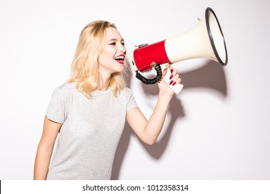 beautiful shocked woman screaming into megaphone, isolated