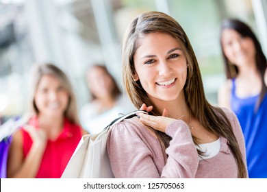 Beautiful shopping woman with her friends smiling