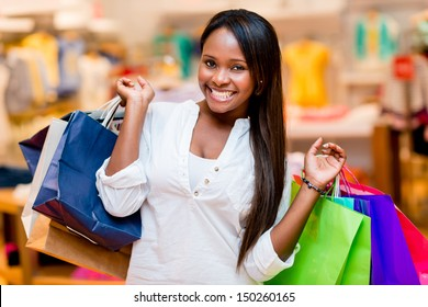 Beautiful shopping woman smiling and holding bags