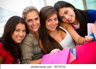 Beautiful shopping women with bags and smiling
