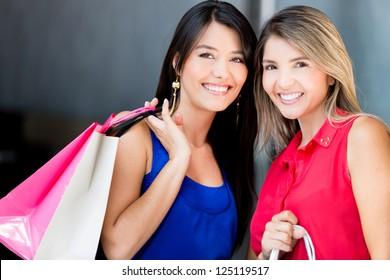 Beautiful shopping women looking very happy