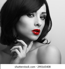 Beautiful short hair style woman with red lips looking sexy. Black and white contrast closeup portrait