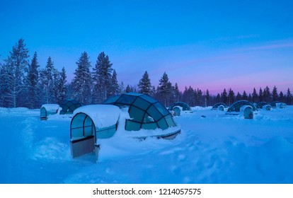 Beautiful shot of pristine snow slightly covering the cool glassy igloos serving as tourist observatories. Spectacular morning in the fun tourist resort in the Scandinavian winter. Empty glass houses.