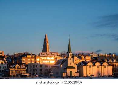 Beautiful shot of Reykjavik downtown with lutheran church in a golden evening light. Capital city of Iceland Reykjavik in winter.